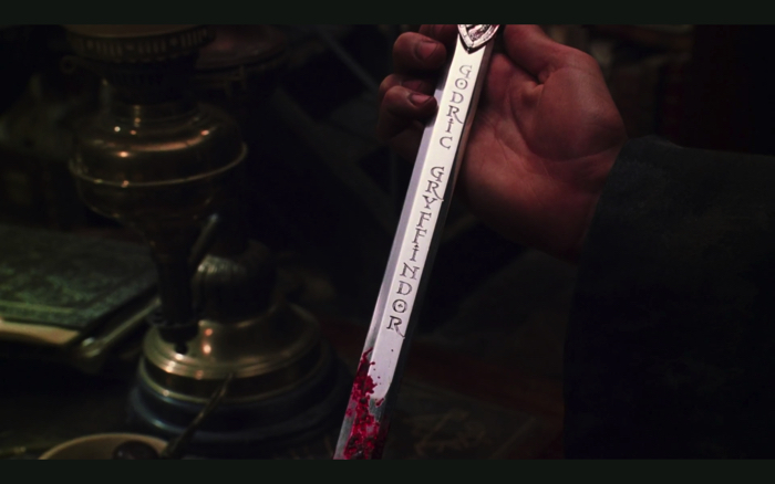 "The name of Godric Gryffindor was carved from the movie ""Harry Potter and the Chamber of Secrets"", the sword of Gryffindor"